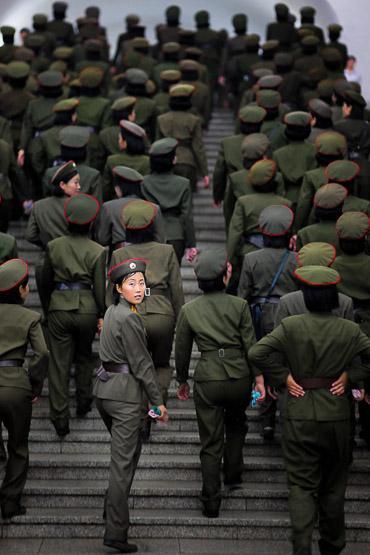 soldier, north korea, subway, metro